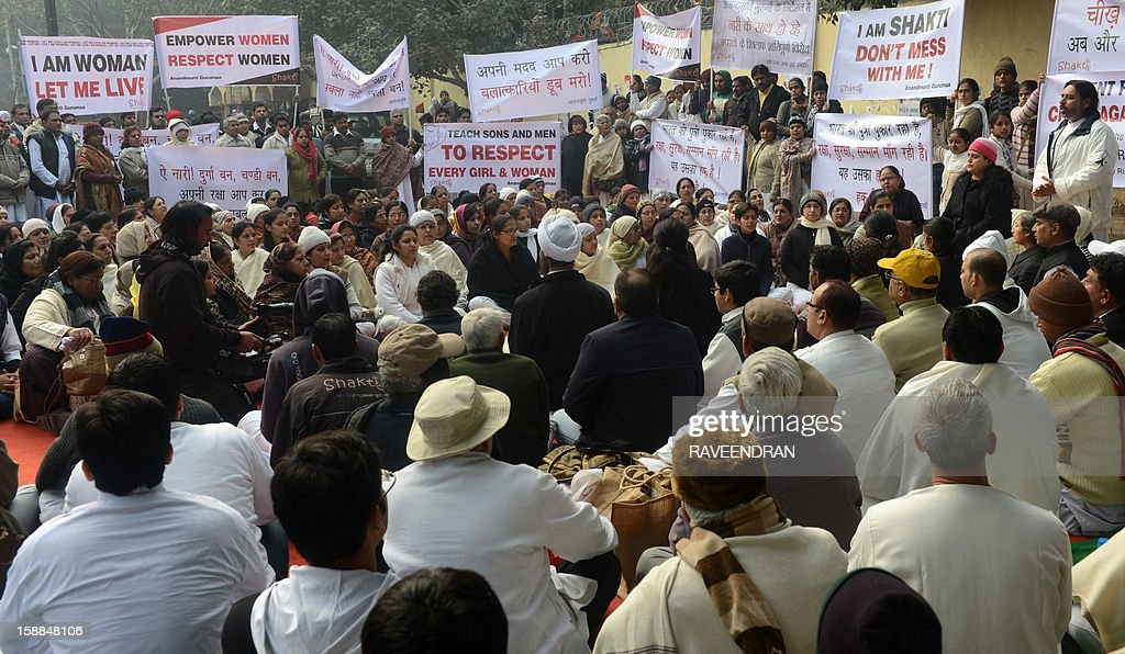 Indian residents gather to pray for gang-rape student victim during a silent protest in New Delhi on January 1, 2013. The family of an Indian gang-rape victim said that they would not rest until her killers are hanged as police finalised their investigation before charges are laid against suspects this week. As the ruling Congress party reportedly pushed for tougher punishments for sex crimes, including chemical castration, authorities in New Delhi launched a hotline to improve safety for women in a city dubbed 'India's rape capital'.