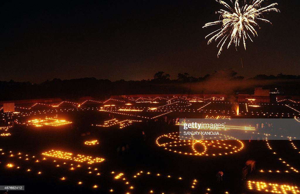 Indian residents light candles and lamps at the Madan Mohan Malviya stadium on the eve of the Hindu festival Diwali in Allahabad on October 22 2014...