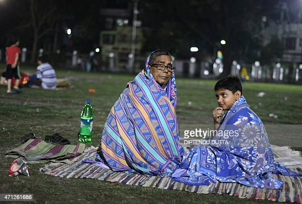 Indian residents rest and sleep in a football field in Siliguri on April 26 2015 after a 78 magnitude earthquake hit the region on April 25 in Nepal...