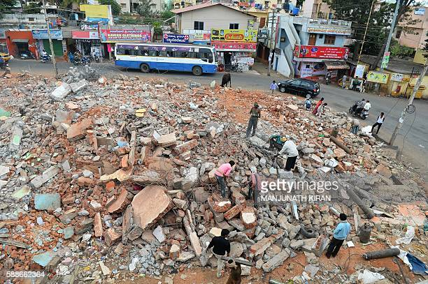 Indian residents salvage usable items amidst the debris of demolished houses a day after Bangalore's municipal authority Bruhat Bengaluru Mahanagara...
