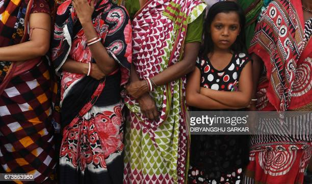Indian residents wait to welcome Bharatiya Janta Party national president Amit Shah in a neighbourhood in Kolkata on April 27 2017 The BJP leader's...