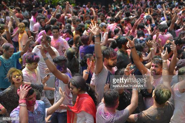 Indian revellers celebrate the festival of Holi in Bangalore on March 13 2017 Holi the festival of colours is a riotous celebration of the coming of...