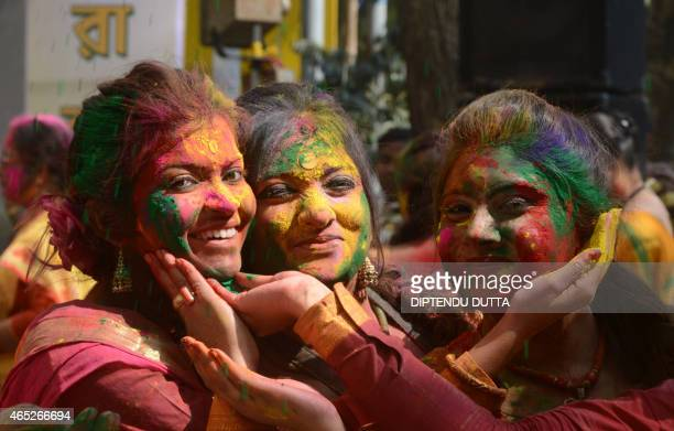 Indian revellers cover each other with coloured powder during the celebrations of Vasantotsav 'the Festival of Spring' in Siliguri on March 5 2015...