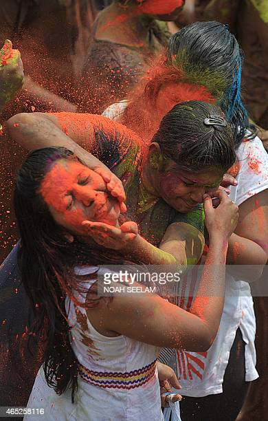 Indian revellers play with color during Holi celebrations in Hyderabad on March 5 2015 Holi also called the Festival of Colours is a popular Hindu...
