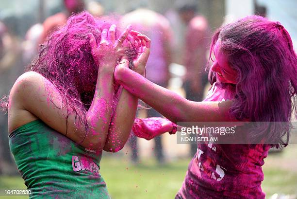 Indian revellers play with coloured powder during Holi celebrations in Hyderabad on March 27 2013 Holi also called the Festival of Colours is a...