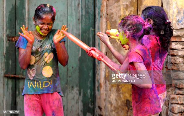 Indian revellers play with colours during Holi celebrations in Chennai on March 13 2017 The Hindu festival of Holi or the 'Festival of Colours'...