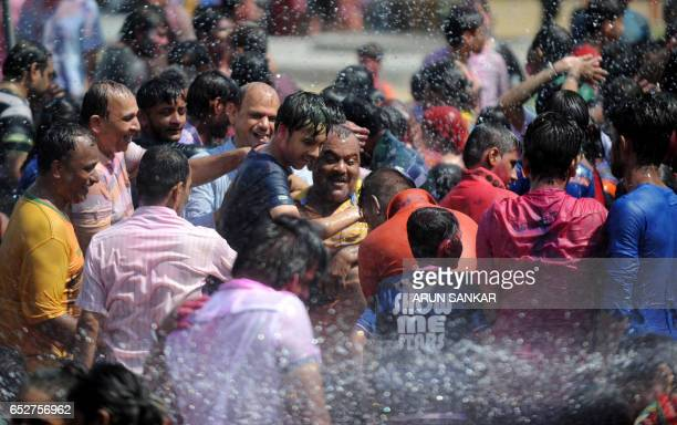 Indian revellers take part in Holi celebrations in Chennai on March 13 2017 The Hindu festival of Holi or the 'Festival of Colours' heralds the...