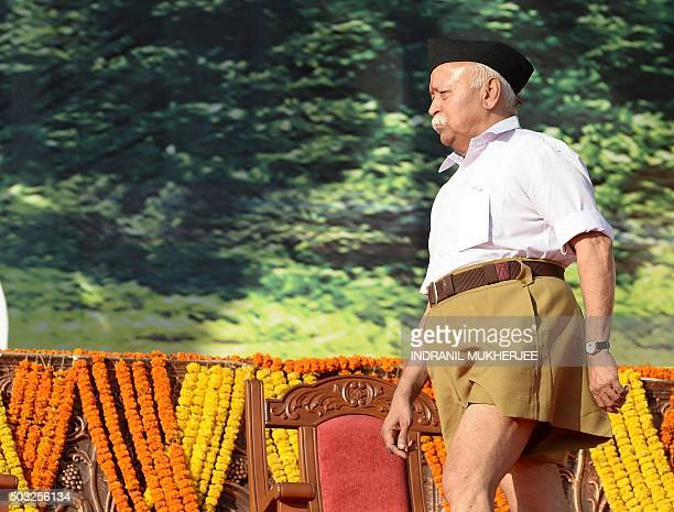 Indian right wing Rashtriya Swayamsevak Sangh chief Mohan Bhagwat arrives at a rally in Pune some 135 kms from Mumbai on January 3 2016 Over 150000...