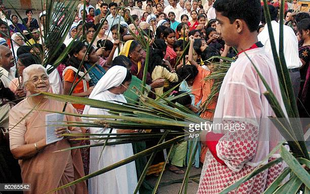 Indian Roman Catholic church Altar boys distribute palm leaves at St Mary's Church in Secunderabad the twin city of Hyderabad on March 16 on the...