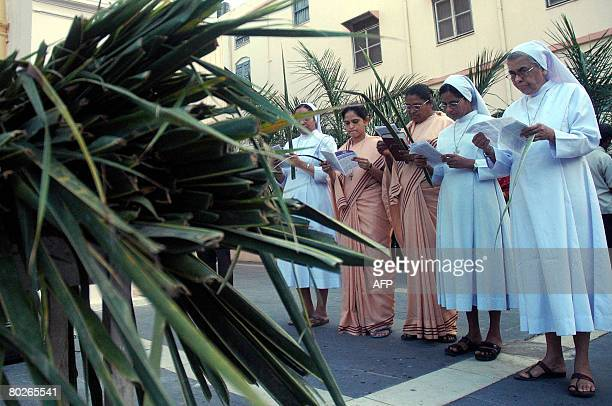 Indian Roman Catholic nuns sing songs during the blessing of palm leaves at St Mary's Church in Secunderabad the twin city of Hyderabad on March 16...