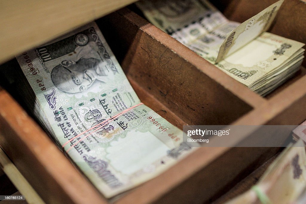 Indian rupee banknotes of various denominations sit in a drawer at a HDFC Bank Ltd. bank branch in Mumbai, India, on Friday, Feb. 1, 2013. HDFC Bank, India's second-largest lender by market value, is seeking to expand in the rural market of the world's second-most populated nation to bolster profits as competition in its cities intensifies. Photographer: Dhiraj Singh/Bloomberg via Getty Images