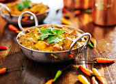 indian saag paneer curry in balti dish with cilantro garnish
