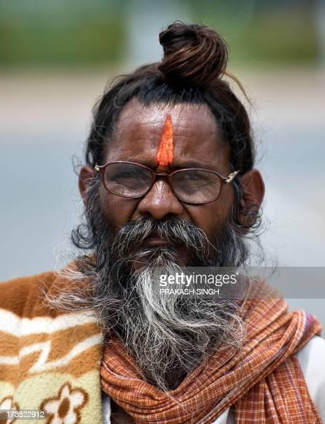 A Indian sadhu holy man with long hair and beard in New Delhi on July 16 2013 AFP PHOTO/ Prakash SINGH