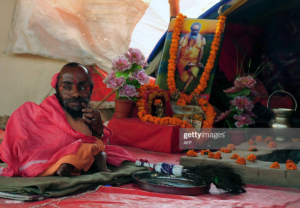 Indian Sadhu Mahadev Bharti, 56, with a height 46 cm sits inside his tent during the Maha Kumbh festival at Sangam, the confluence of the rivers Ganges, Yamuna and mythical Saraswati in Allahabad on January 29, 2013. The Kumbh Mela in the Indian town of Allahabad will see up to 100 million worshippers gather over 55 days to take a ritual bath in the holy waters, believed to cleanse sins and bestow blessings. AFP PHOTO/ Sanjay KANOJIA