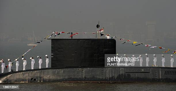 Indian sailors stand on the deck of a submarine during a Fleet Review in Mumbai on December 20 2011 Indian President Pratibha Patil who reviewed a...
