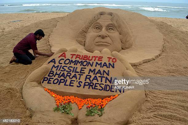 Indian sand artist Sudarsan Pattnaik gives tribute through his sand sculpture to India's former president and scientist A P J Abdul Kalam at Puri...
