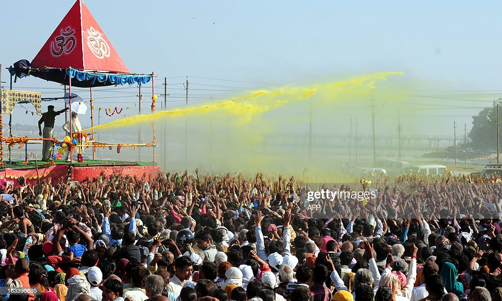 Indian Sant Asaram Bapu (2L) plays Holi with his followers during the Kumbh Mela festival in Allahabad on March 9, 2013. A record number of 120 million pilgrims have cleansed off their sins after taking a dip in an Indian river during the two-month-long Kumbh Mela festival that draws to an end on March 10.