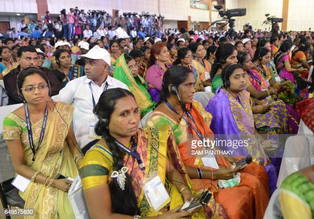 Indian sarpanches attend a 'Swachh Shakti 2017' award ceremony attended by Indian Prime Minister Narendra Modi in Gandhinagar some 30 km from...