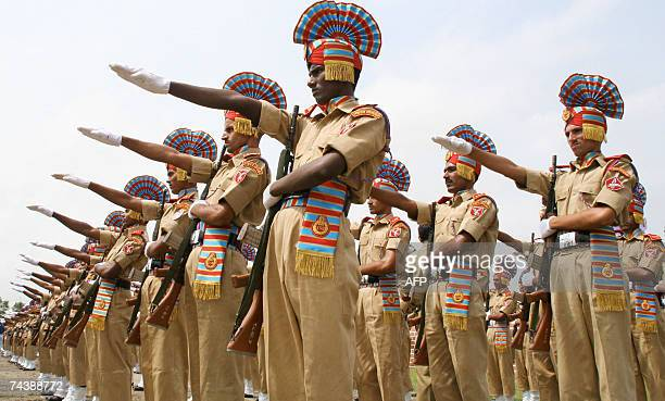 Indian Sashastra Seema Bal personell part of a batch of 496 new soldiers take the oath during a passing out parade at a recruitment centre at...