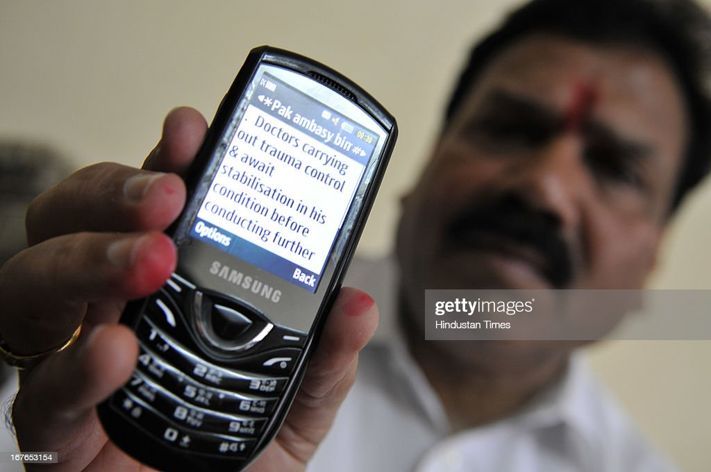Indian SC Commission Vice President Dr. Raj Kumar Verka showing the SMS sent by Indian Embassy in Pakistan, in which they had given detail about Sarabjit's health and security, on April 27, 2013 in Amritsar, India. Sarabjit's family members will apply for Pakistani Visa to meet Sarabjit in Pakistani hospital. According to sources, Sarabjit was hit on the head with bricks, and his neck and stomach were cut with blades. Sarabjit was admitted to the state-run Jinnah Hospital with a severe head injury on Friday evening. He was convicted for alleged involvement in a string of bomb attacks in Punjab province that killed 14 people in 1990.