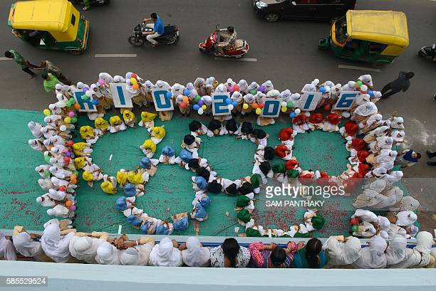 TOPSHOT Indian school children form the emblem of the Rio 2016 Summer Olympics in Ahmedabad on August 3 2016 Some 150 students and 15 staff members...
