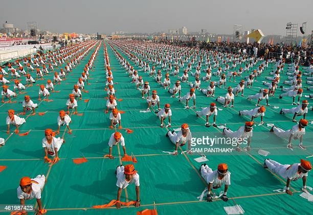 Indian school children from municipalrun schools participate in the 'Surya Namaskar' event during the inaugural ceremony of the International Kite...