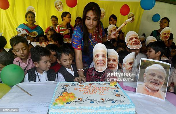 Indian school children of Bright Academy wear the masks of Indian Prime Minster Narendra Modi as a precelebartion of his 64th birthday in Siliguri on...