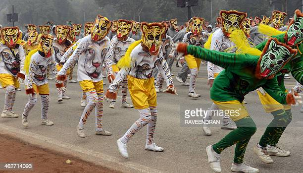 Indian school children perform a Pulikali during a rehearsal for the Indian Republic Day parade in New Delhi on January 15 2014 India will celebrate...