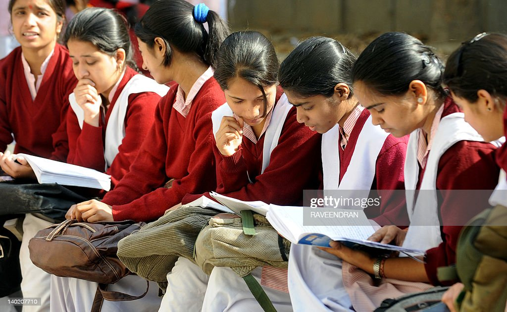 Indian school children prepare for their Central Board of Secondary Education (CBSE) senior school certificate examinations for Class XII standard, by looking at their textbooks in the last moments before entering an examination hall in New Delhi on March 1, 2012. The CBSE has for the first time, made the Class X exam optional this year onwards, a large percentage of students have chosen this option. This is seen as an attempt to reduce the exam related stress.
