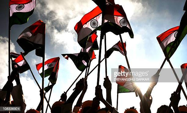 Indian school children wave Indian national flags during a Republic Day parade in Bangalore on January 26 2011 India celebrated its 62nd Republic Day...
