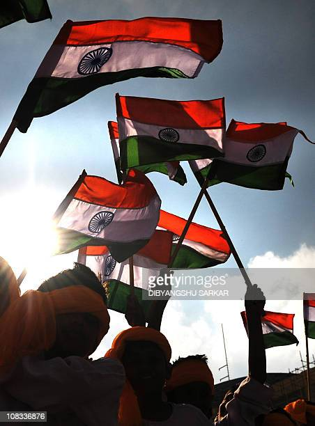 Indian school children wave Indian national flags prior to a cultural programme as part of the Republic Day parade in Bangalore on January 26 2011...