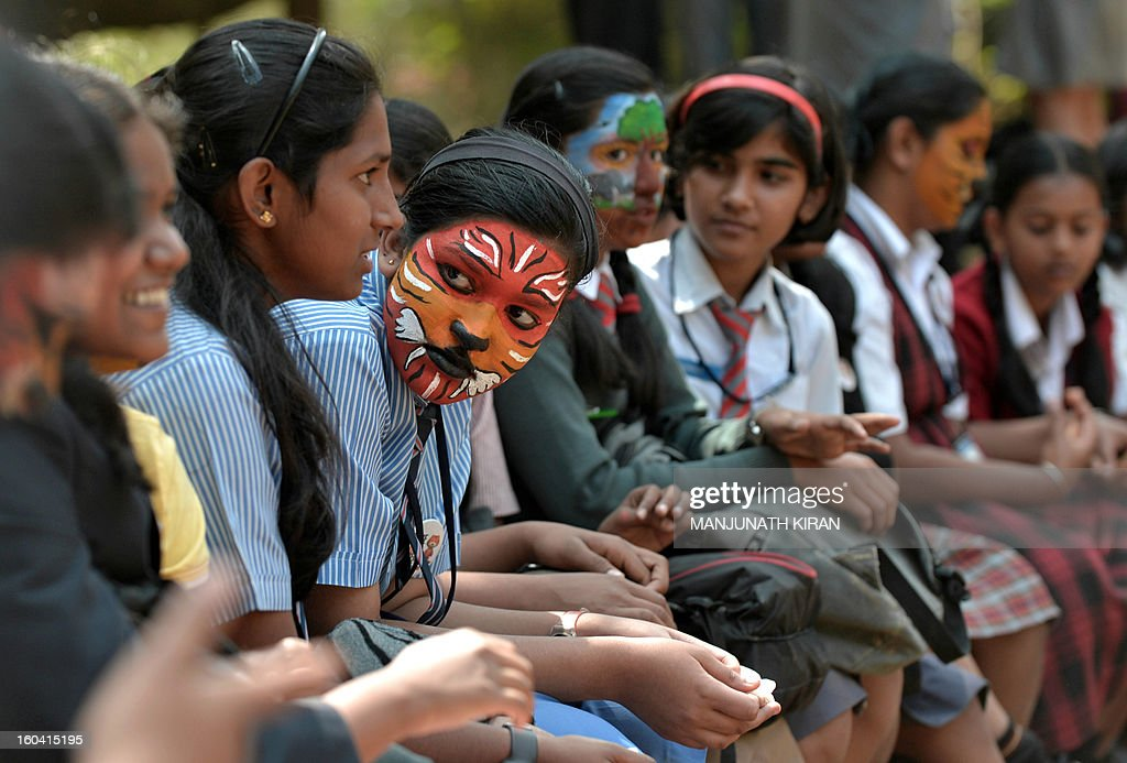 Indian school children with their faces painted take part in the 'Save Tiger Campaign' organised by the environmental magazine 'Sanctuary Asia' and conservation program 'Kids for Tigers' in Bangalore on January 31, 2013. The tiger census in India for 2012 stated that the total number of tigers in the country is between 1500 and 1800. AFP PHOTO/Manjunath KIRAN