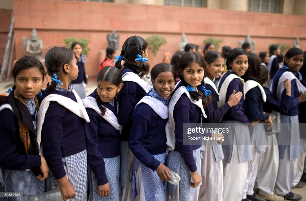 Indian school girls line up to enter the National Museum in New Delhi, India February 2, 2008. With the nation's rapid economic growth, Indian middle class families are having difficulty finding places in quality schools for their children. City governments have not kept pace with primary or secondary school construction forcing an increased demand at private schools.