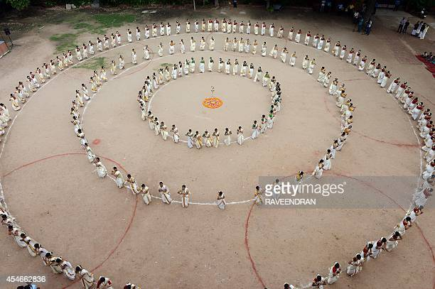 Indian school girls wear saree as they perform a Thiruvathirakali a popular group dance ahead of the Onam festival and on Teachers' Day at a school...