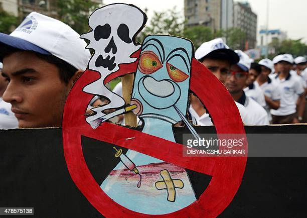 Indian school students hold placards during an event to mark International Day against Drug Abuse and Illicit Trafficking in Kolkata on June 26 2015...