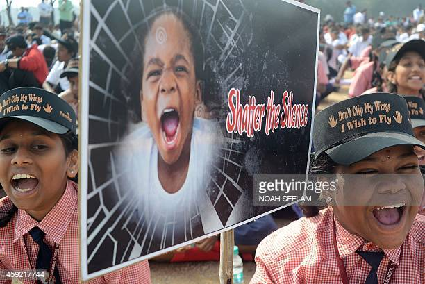 Indian school students shout slogans as they participate in an awareness Campaign against Child Sex Abuse in Hyderabad on November 19 the World Day...