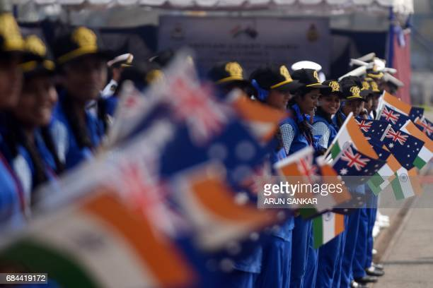 Indian school students wave Australian and Indian national flag as Australian Border Force Cutter Ocean Shield is arrives at a port in Chennai on...