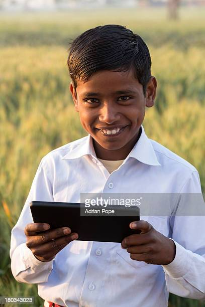 Indian schoolboy posing with tablet device