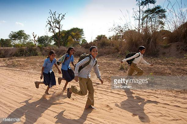Indian schoolboys and girls walking to school at Doeli in Sawai Madhopur Rajasthan Northern India
