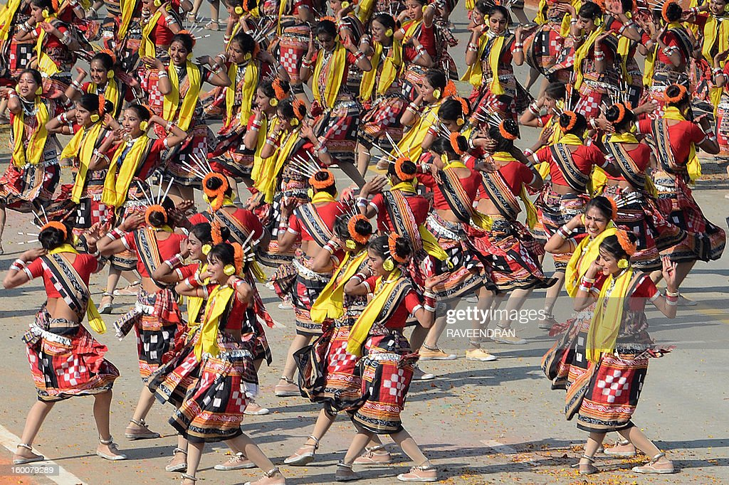 Indian schoolchildren perform a dance during the Republic Day parade in New Delhi on January 26, 2013. India marked its Republic Day with celebrations held under heavy security, especially in New Delhi where large areas were sealed off for an annual parade of military hardware at which Bhutan's king Jigme Khesar Namgyel Wangchuck was chief guest.