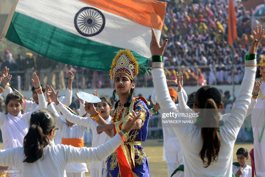 Indian schoolchildren perform during a ceremony to celebrate India's 64th Republic Day parade at The Guru Nanak Stadium in Amritsar on January 26, 2013. India celebrated its 64th Republic Day with a military parade in several towns across the country. AFP PHOTO/NARINDER NANU