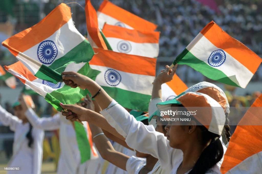 Indian schoolchildren perform during a ceremony to celebrate India's 64th Republic Day parade at The Guru Nanak Stadium in Amritsar on January 26, 2013. India celebrated its 64th Republic Day with a military parade in several towns across the country.
