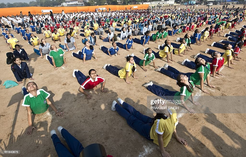 Indian schoolchildren perform morning yoga sun salutations (Surya Namaskar) at Ramlila Maidan in New Delhi on February 18, 2013. Surya Namaskar programmes were organised February 18 across the country on the occasion of Swami Vivekananda's 150th birth anniversary. AFP PHOTO/ Prakash SINGH