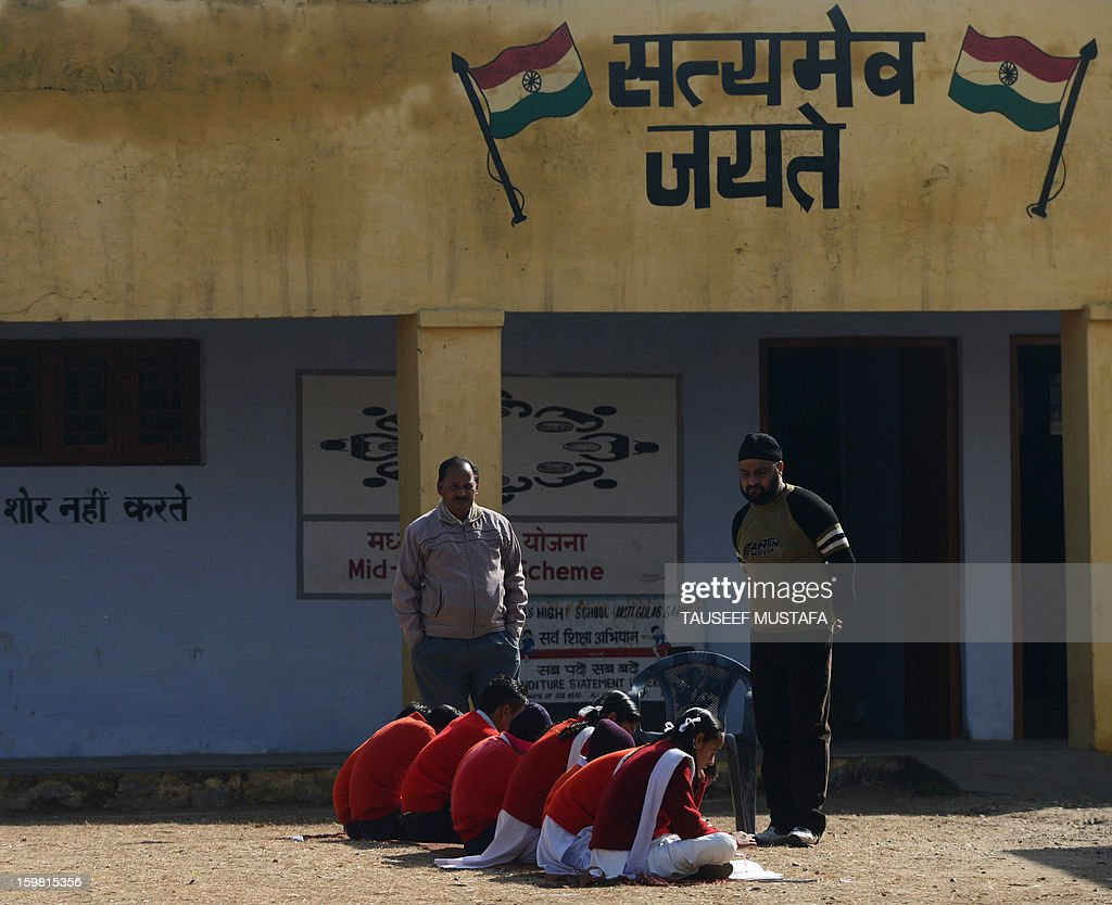 Indian schoolchildren study at a school near the India-Pakistan border in Suchit-Garh, some 36 kms southwest of Jammu, on January 21, 2013. On both sides of the de facto border in Kashmir, villagers living on one of the world's most dangerous flash points have special reason to fear the return of tension between India and Pakistan. The spike in cross-border firing in Kashmir -- a region claimed wholly by both India and Pakistan -- has seen five soldiers killed in recent days and threatened to unravel a fragile peace process that had begun to make progress. AFP PHOTO/ Tauseef MUSTAFA