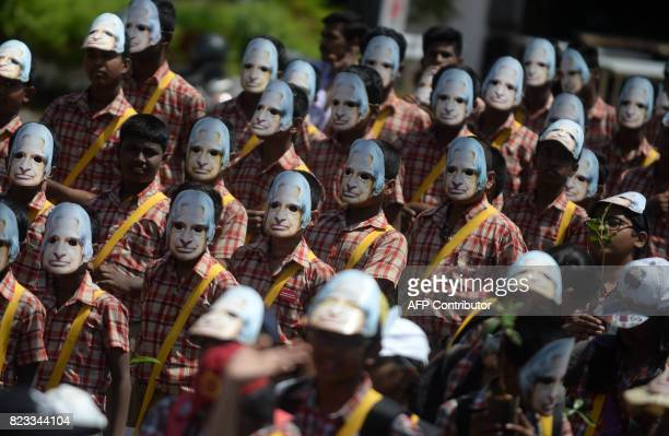 TOPSHOT Indian schoolchildren wear masks bearing the image of former Indian president APJ Abdul Kalam on the second anniversary of his death in...