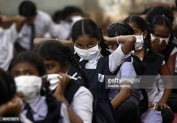 Indian schoolgirls have taken to wearing masks to avoid contracting swine flu in Mumbai India on 20 February 2015 Forty more deaths due to contagious...