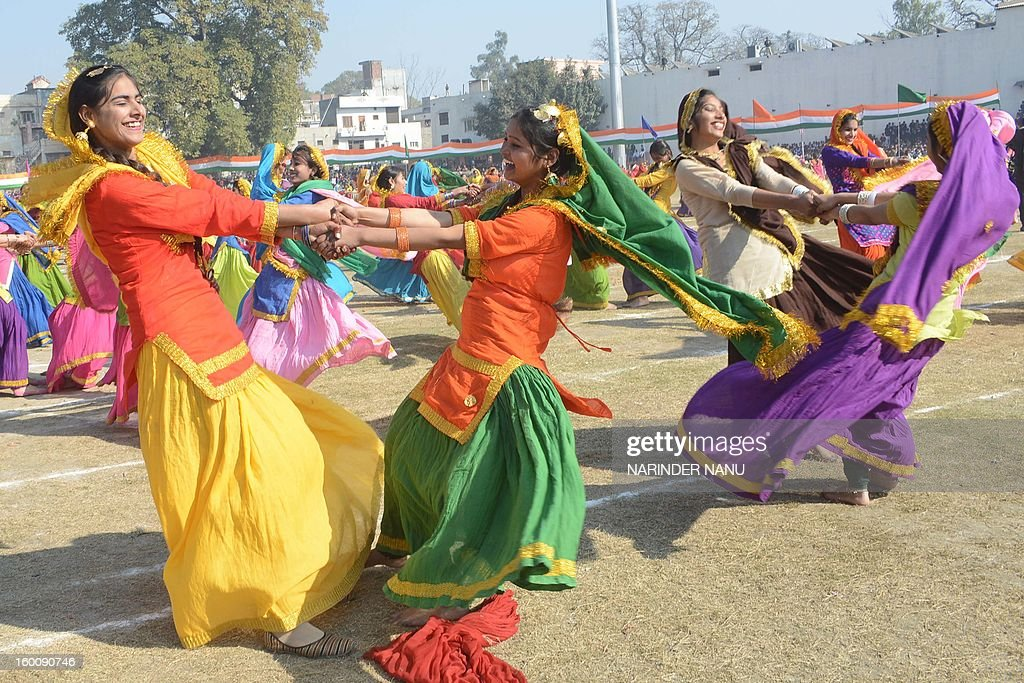 Indian schoolgirls perform a giddha dance during a ceremony to celebrate India's 64th Republic Day parade at The Guru Nanak Stadium in Amritsar on January 26, 2013. India celebrated its 64th Republic Day with a military parade in several towns across the country. AFP PHOTO/NARINDER NANU