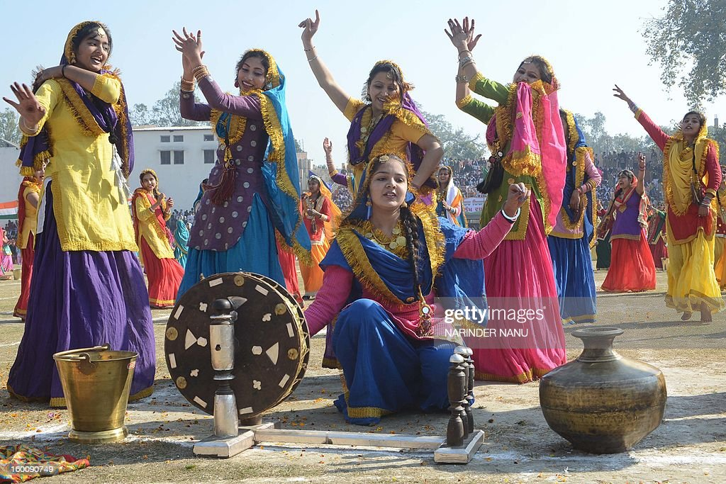 Indian schoolgirls perform a giddha dance during a ceremony to celebrate India's 64th Republic Day parade at The Guru Nanak Stadium in Amritsar on January 26, 2013. India celebrated its 64th Republic Day with a military parade in several towns across the country.