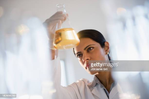 Indian scientist examining chemicals in lab