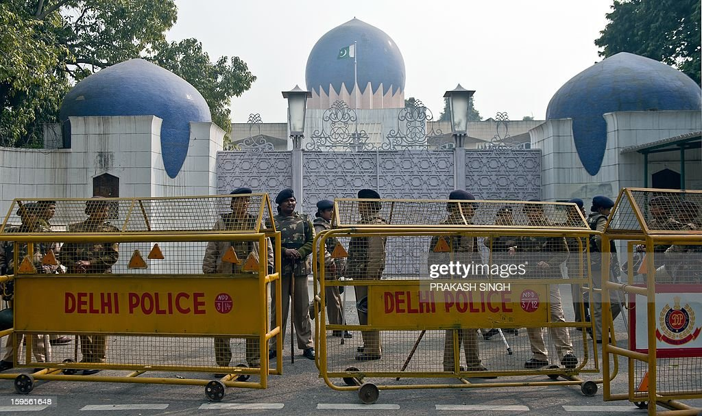 Indian securioty personnel stand guard outside the Pakistan High Commission during a demonstration by students from Jamia Millia Islamia, Jawaharlal Nehru University, and Hamdard University against what they claim is a genocide against the ethnic Hazara community in Pakistan, in New Delhi on January 16, 2013. The students participated in the demonstration to condemn the twin suicide attacks in Pakistan which killed 92 people in the southwestern city of Quetta on January 10. AFP PHOTO/ Prakash SINGH